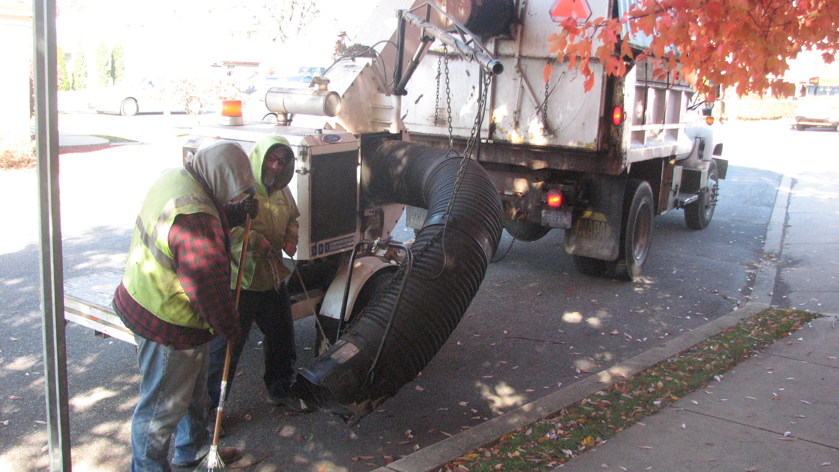 Street Sweeper and 2 Public Works Employees